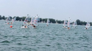 Junior Sailors race to the start of a simulated race on Lake Wawasee.