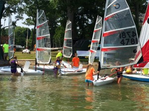 Wawasee Yacht Club junior sailors prepare their Open Bics for the water before racing as part of the Junior Sail Program. (Photos by Mike Deak)