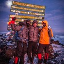 John Burkett, Mark Nolan and Tommy Danger stand at the peak of Mt. Kilimanjaro in Tanzania after reaching the summit of the first of seven mountains.