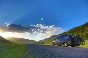 The van, which acted as a support system for the Tour Divide riders, and a working home environment for the Geigers can be seen here driving off into the sunrise. (Photo by the Geigers)