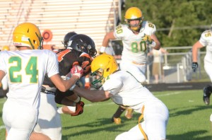 Valley defenders put a stop on Warsaw's Dylan Childers (Photo by Scott Davidson)