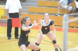 Caroline Mayer passes the ball for the Tigers.