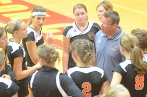 Coach Mike Howard instructs his team during a break between sets.