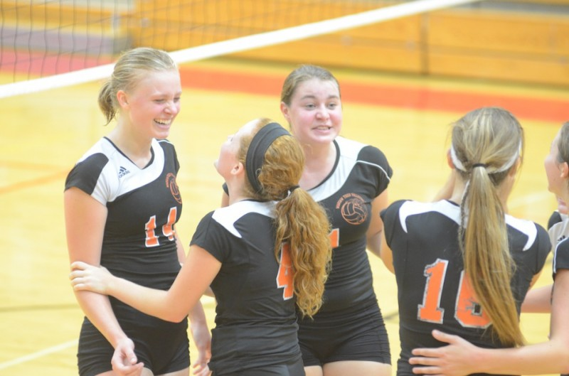 Katie Voelz is all smiles after a big point for her Warsaw volleyball team Thursday night. The Tigers rallied to knock off Elkhart Memorial 3-2.