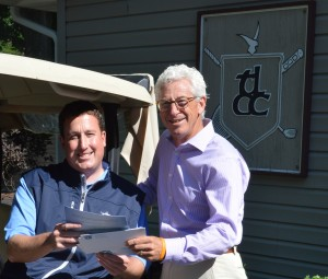 Ron Smock, right, chairman of the 2014 Steve Dodds Charity Golf Tournament for the Cancer Care Fund of Kosciusko County, makes sure Matt Funkhouser, head golf professional and Tippecanoe Lake County Club, has plenty of entry forms for this years event. The golf tournament will return to Tippecanoe Country Club on Monday, Sept. 8. Teams will have a choice between an 8 a.m. or 1 p.m. tee time. (Photo by Deb Patterson)