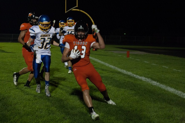 Brock Riley hauls in the game winning two-point conversion for the Tigers (Photo by Ansel Hygema)
