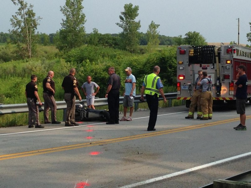 Investigating the scene of a motorcycle accident south of Warsaw. (Photo by John Faulkner)