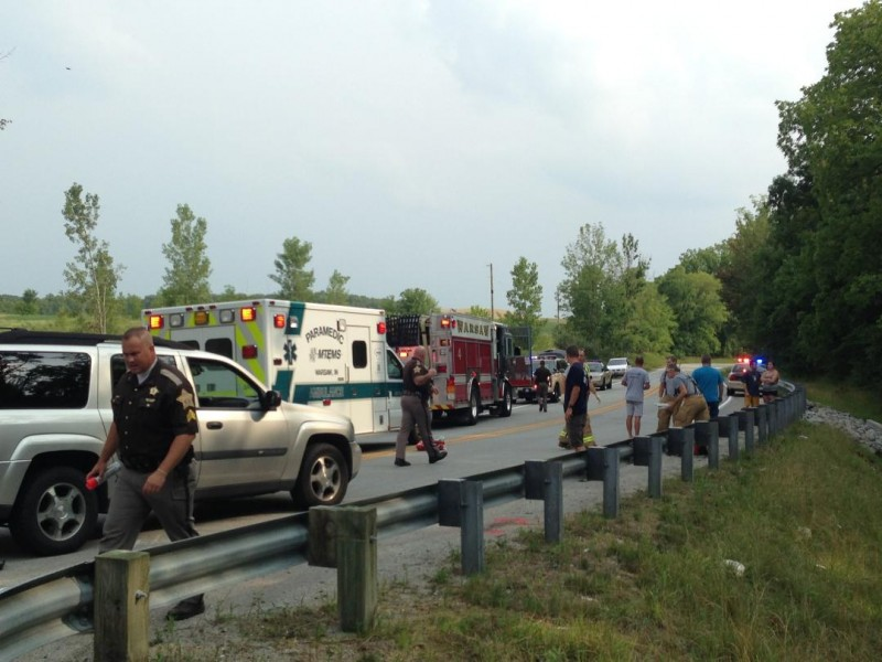 Police, fire and medics respond to the scene of a motorcycle accident south of Warsaw. (Photo by John Faulkner)