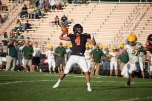 Riley Rhoades lets loose with a pass for the Tigers (Photo  by Ansel Hygema)