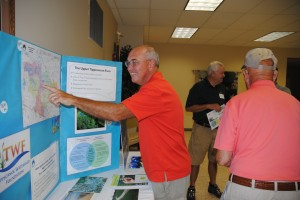 Tippecanoe Watershed Foundation supporter Ted Titus looks at a map of the area served by TWF and locates his property.