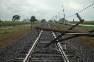 Two downed utility poles block the railroad tracks about a mile south of Milford Tuesday afternoon. The poles were felled by straight line winds about 3:30 p.m. and train traffic was restored around 6:15 p.m.