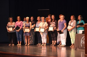 Support Staff Member of the Year Nominees stand on-stage during the awards ceremony.  (Photo by Alyssa Richardson)