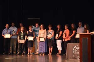 Teacher of the Year Nominees stand on-stage during the awards ceremony.  (Photo by Alyssa Richardson)