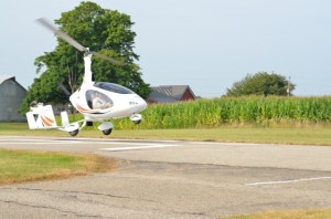 PREPARING FOR TOUCHDOWN — A home-built kit gyroplane prepares for landing at the Mentone Airport. (Photo by Keith Knepp)