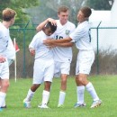 Carlos Camargo (center) is congratulated by his teammates after evening up the score 2-2 against Concord.