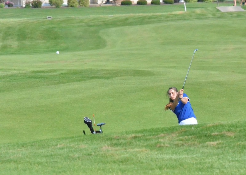 Triton's Kayla Kraft hits on to the number one green at Stonehenge. (Photos by Nick Goralczyk)