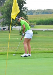 Mikala Mawhorter sets up before sinking a putt for eagle at South Shore Golf Club. (Photos by Nick Goralczyk.)