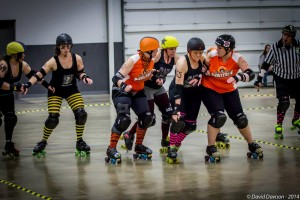 Members of the Bone City Rollers block a jammer during the February bout with Dire Skates of Richmond. (Photo by David Davison)
