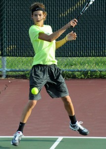 Todd Hauser fires a shot at Central Noble in the one doubles match Tuesday night. (Photos by Mike Deak)