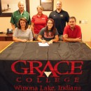 Wawasee High School senior Paige Hlutke has signed a letter of intent to continue her softball career with Grace College. Seated with Paige are parents Jen and Glenn Hlutke. In the back row are Wawasee athletic director Steve Wiktorowski, Grace College softball head coach Heather Johnson and Wawasee softball head coach Jared Knipper. (Photo by Mike Deak)