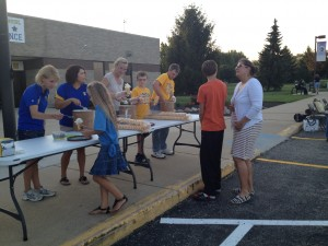 Pictured serving ice cream to members of the PJ Hanley family are: Terri Barnhart, Diana Westphal, Louise Mason, Travis Barnhart and Ken Barnhart. (Photo provided)