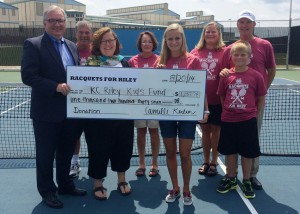 A check for $1,237.78 was presented by Camille Kerlin, center, to the Kosciusko County Riley Kids Fund from the Racquets For Riley campaign held in July. Standing in the front row are Mike Bergen, co-founder of Kosciusko County Riley Kids Fund, Suzie Light, executive director of the Kosciusko County Community Foundation, Camille Kerlin, and Carson Kerlin. In the back row are Warsaw Community High School tennis coach Rick Orban, WCHS tennis assistant Jan Orban, Diane Kerlin and Rick Kerlin.