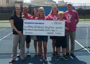 A check for $11,375 was presented by Camille Kerlin, center, to Riley Children's Foundation from the Racquets For Riley campaign held in July. Standing in the front row are Alana Helmer, representing Riley Children's Foundation, and Carson Kerlin. In the back row are Warsaw Community High School tennis coach Rick Orban, WCHS tennis assistant Jan Orban, Diane Kerlin and Rick Kerlin. (Photos by Mike Deak)