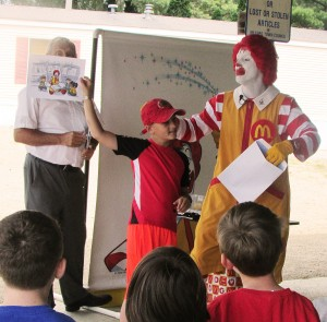 Devin VanLue participates in a game showing Ronald McDonald reading at the Grand Finale Picnic on July 31. (Photo provided)