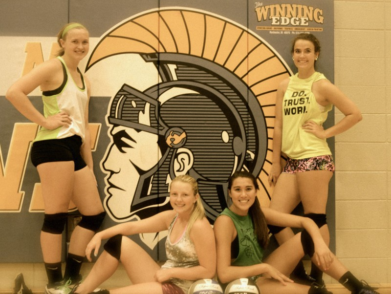The Lady Trojan volleyball program will be strong with returners, from left, Laura Hostrawser, Krystal Sellers, Jaela Meister and Becca Kennedy. (Photo by Scott Davidson)