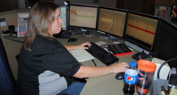 Dispatcher Tara Smith takes a 911 call inside the Kosciusko 911 Communications Center in Warsaw.