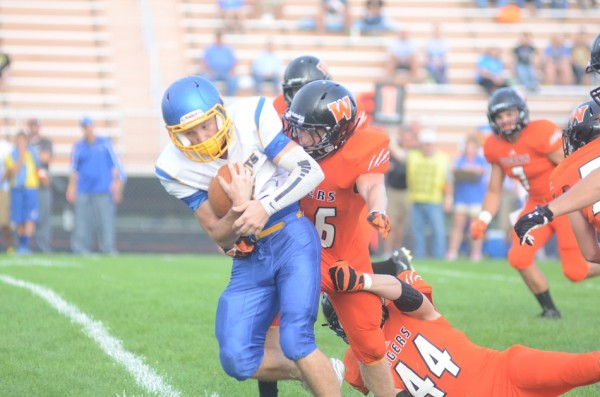 The Warsaw defense, shown tackling an East Noble player last week, will be tested at Plymouth Friday night.