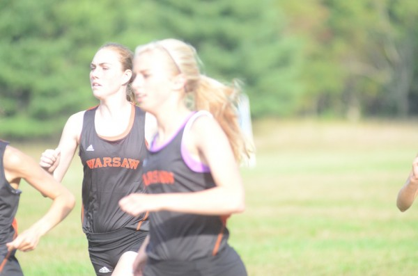Hannah Dawson (in the background) led Warsaw to two big NLC wins.
