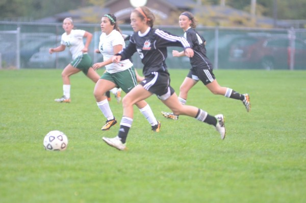 Brenna Shipley makes a run for the Tigers at Concord Thursday night.