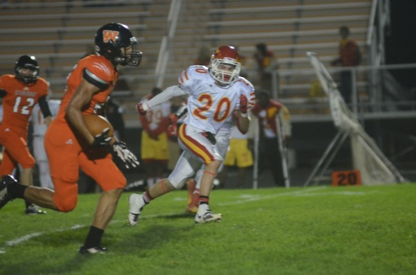 Jeremy David heads for a touchdown for the Tigers.