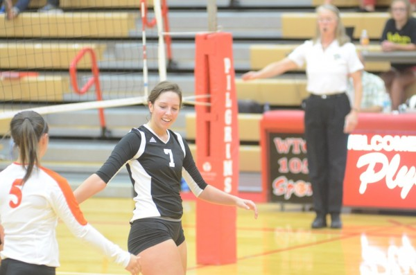 Celia Heckert is all smiles after a Warsaw point versus Plymouth.