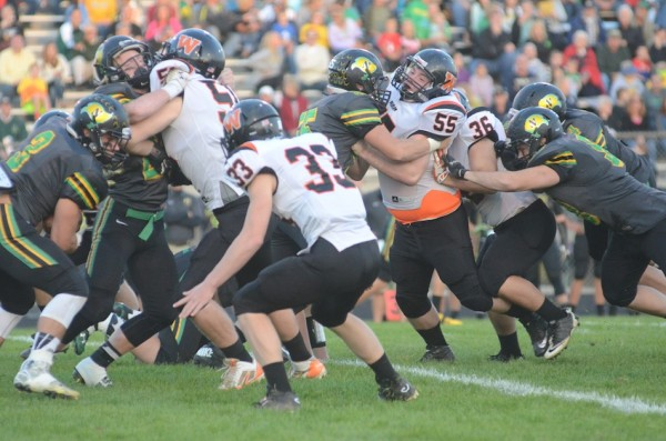 Ross Armey eyes a Northridge running back. Armey had a huge blocked punt for the Tigers.