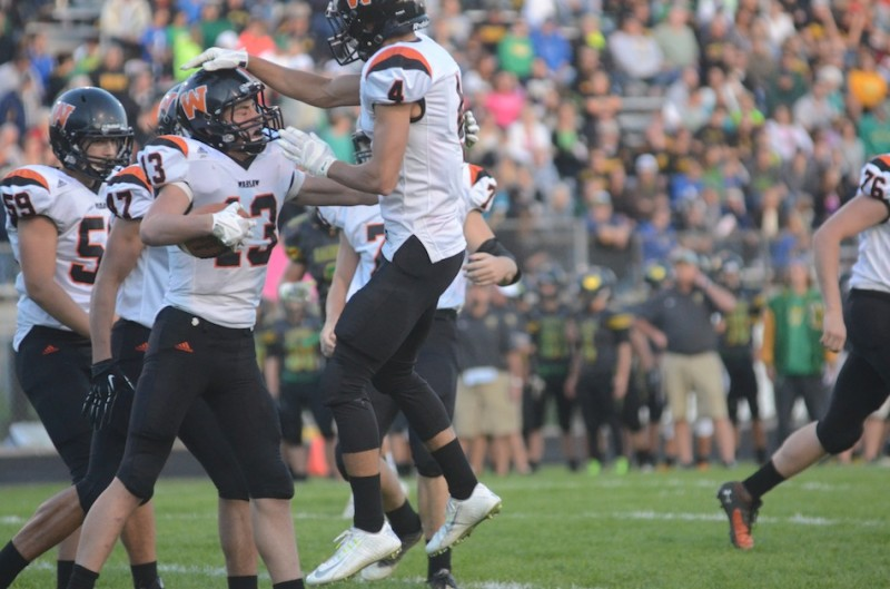 Riley Rhoades congratulates Brock Riley on a touchdown catch Friday night for the Tigers.