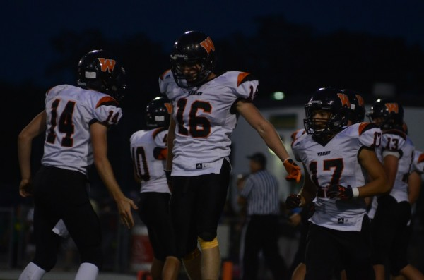 Landan Perry is fired up after an interception return for a touchdown for Warsaw.