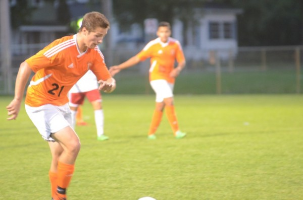 Brandon Reinholt controls the ball for the Tigers.