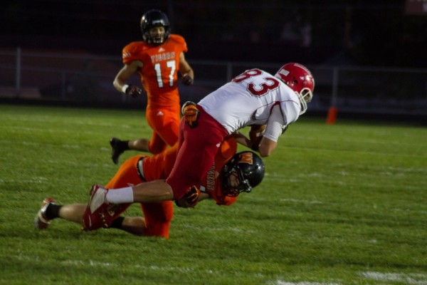 Warsaw's Dylan Childers tackles Goshen tight end Adam Pearson.