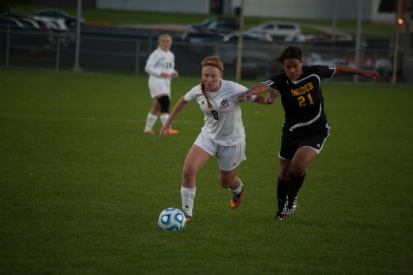 Brooklyn Jackson races the ball past a Snider defender for the Tigers.