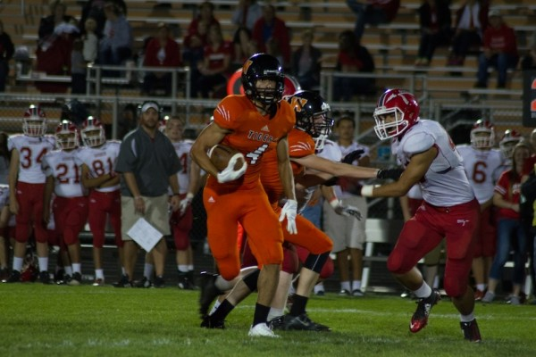 Riley Rhoades is headed for a touchdown for Warsaw Friday night (Photos by Ansel Hygema)