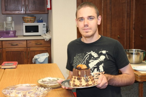 """""""Doctor Who"""" is popular and interesting to many people. Frank Brower is shown with the Dalek cake he created for Wednesday's meeting. Emily Chupp provided a trivia quiz. The group meets once each month at the library and is an opportunity to learn about and meet the worlds of the Doctor. (Photo provided)"""