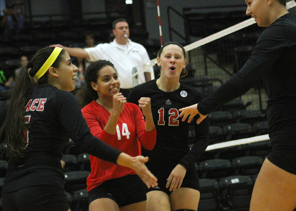 Celebrating a point during Grace's win against Bethel are Annie Salazar, Hannah Clemmons, Alix Underwood and Tori Bontrager. (Photo provided by the Grace College Sports Information Department)