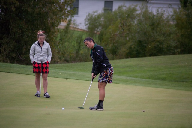 Page Desenberg follows a putt Thursday for the Tigers at Stonehenge.
