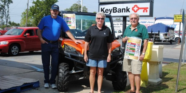 Taking a break from selling tickets to the North Webster Community Center Heart of the Community Auction and Raffle are left, Stu Coverstone, Janet Miller and Jon Sroufe. All are center board members and were in the North Webster NewMarket parking lot. One of the grand prizes, a UTV, is seen behind them. The event is from 5 p.m.-9 p.m., Saturday, at the center, 301 N. Main St. (SR 13).  (Photo by Martha Stoelting)