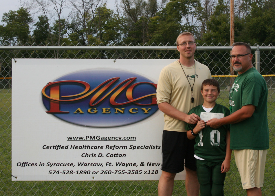 Wawasee Pee Wee Football receives a donation from the PMG Agency.