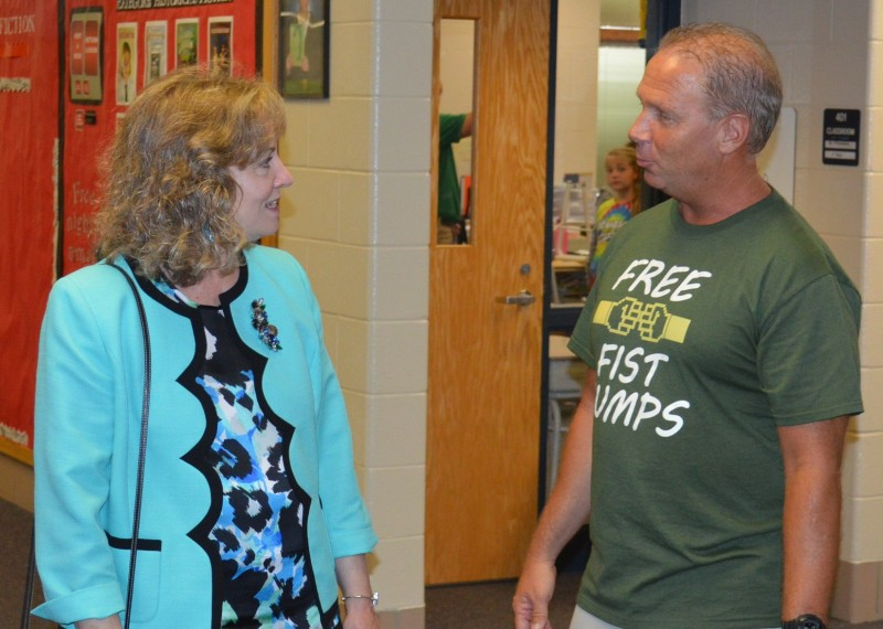 Glenda Ritz, left, state superintendent of public instruction for Indiana, visited briefly with fifth-grade teacher Mitch Willaman in a hallway during her visit to North Webster Elementary School Thursday afternoon.