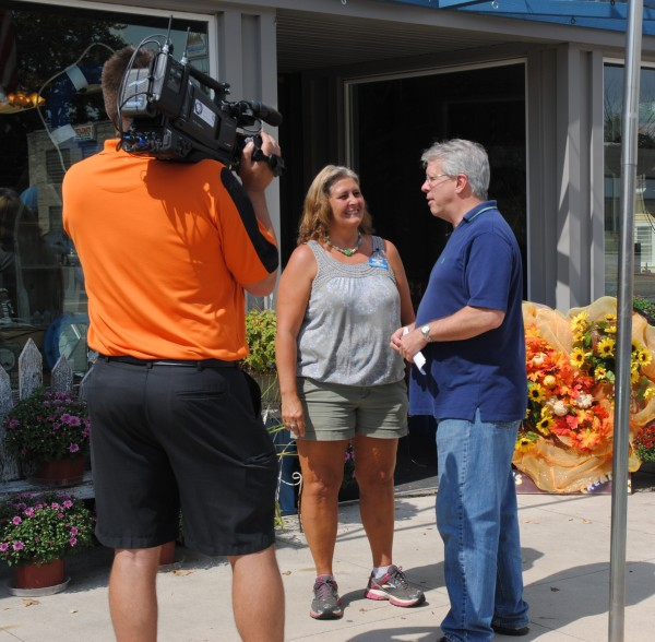 Shown on the left is Gordy Young interviewing Sue Ward, chamber president, about the festival.