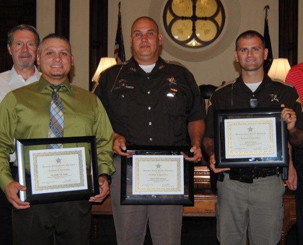 Three Kosciusko County sheriff's deputies were honored at Tuesday's county commissioners meeting in Warsaw. The officers were honored for two separate life-saving efforts Sept. 25, 2013, and Aug. 18. Pictured, from left, are Chris Rager, Don McCune and Neil Likens.